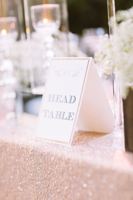 Outdoor wedding head table with sign golden or blush sequined tablecloth