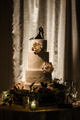 four tiered wedding cake bridal gown lace pattern pale gold sugar flowers silhouette cake topper