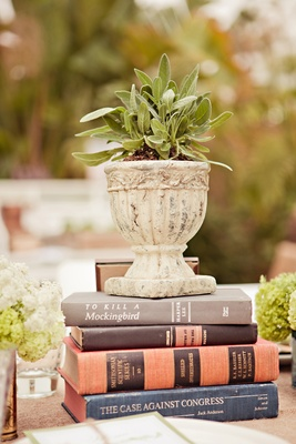 Vintage books hold vessel of sage