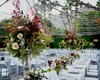 Fall wedding in La Quinta Palm Springs area white linens string lights tent formation fall colors