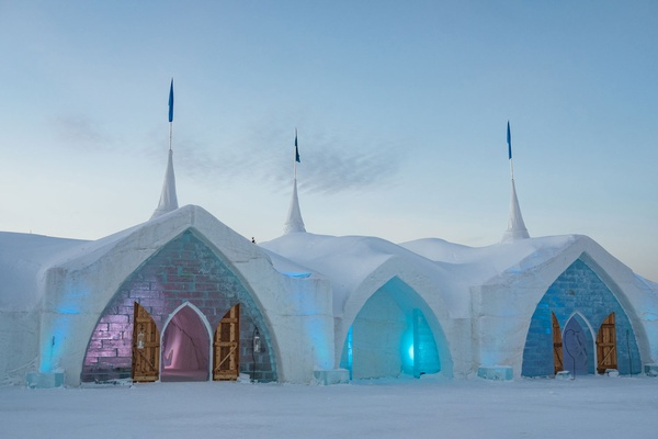 Hotel de Glace in Quebec City winter destination wedding ice castle chapel venue fur wrapped doors