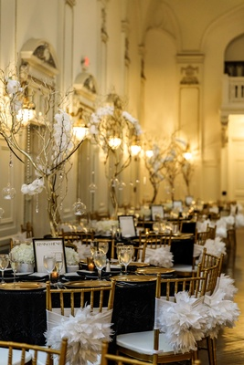 gold chiavari chairs, black linens, gold charger plates, gold manzanita branches