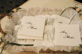 Wicker box displaying simple ceremony booklets