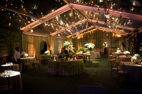At home wedding reception with tent, chandelier at night