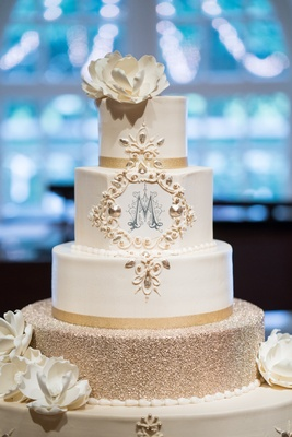 four-layer cake with glitter tier, sugar flowers, m monogram