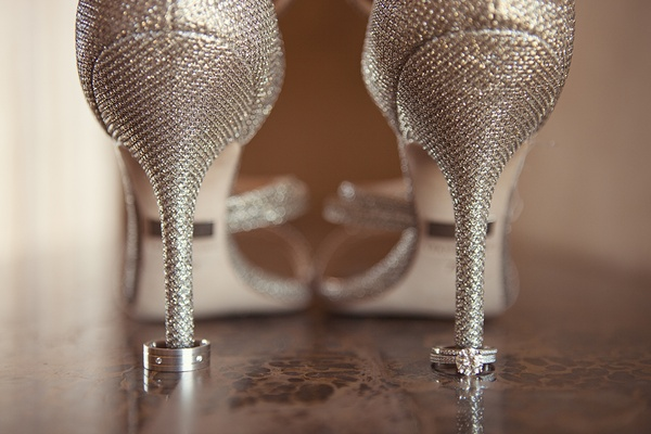 Wedding day men's band with diamonds and bride's engagement ring and diamond band on heels of shoes