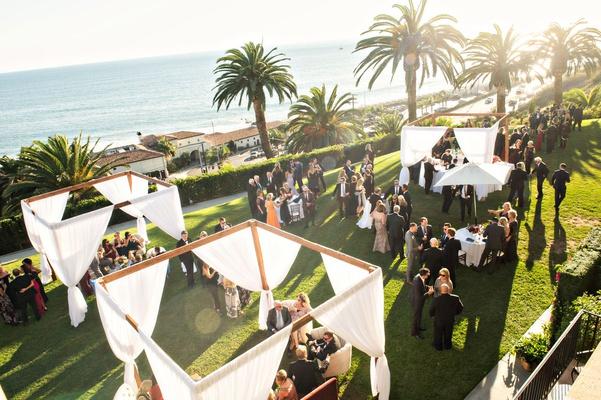 wedding reception cocktail hour at bel air bay club pergola palm tree ocean view