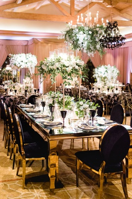 Charlise Castro and George Springer wedding reception table black chair velvet gold table flowers