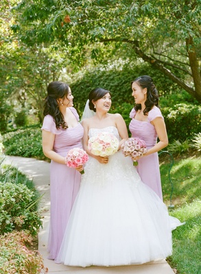 bride and two bridesmaids wearing lavender dresses with fluttery cap sleeves