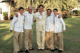 Groom with groomsmen in khaki pants and white shirts