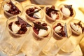 sweet treat desserts in small glasses at couple's wedding reception