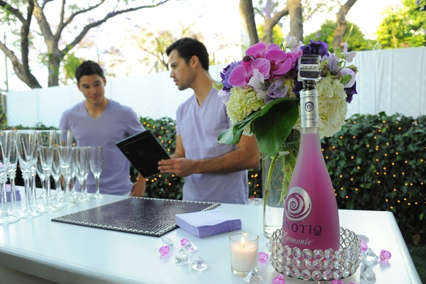 bartenders discuss menu at bridal shower bar