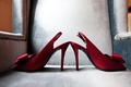 Red satin slingback bridal heels with bow