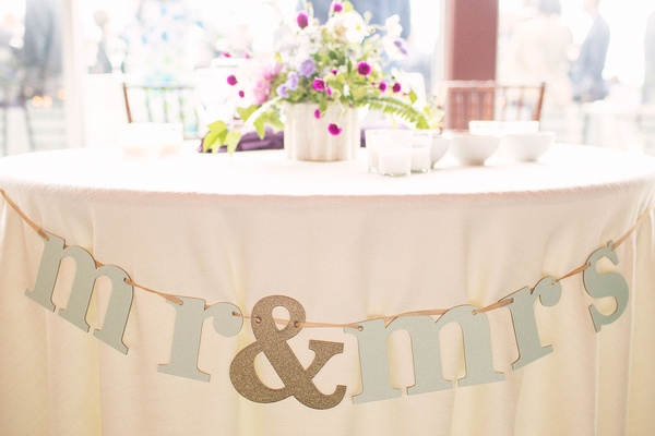 Lyndsy Fonseca and Noah Bean wedding reception sweetheart table mr and mrs banner glitter purple