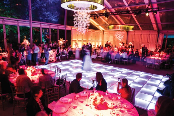 Tented wedding reception with colorful LED dance floor
