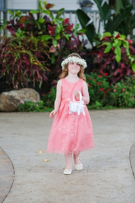 flower girl in coral pink tea length tank dress and flower crown