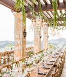 Outdoor terrace wedding wood table no linens runner white pink flowers greenery cut out table number