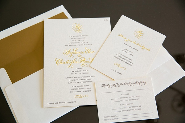 White stationery with gold envelope liner and letterpress print