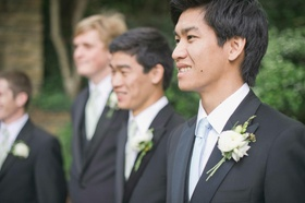 Groom with three groomsmen in tuxedos