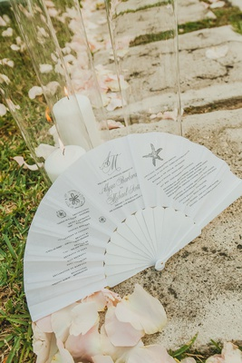 wedding ceremony program printed on folding fan for destination wedding