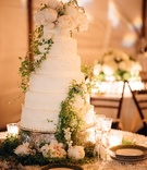 six-tier vanilla wedding cake buttercream green vines and white peonies