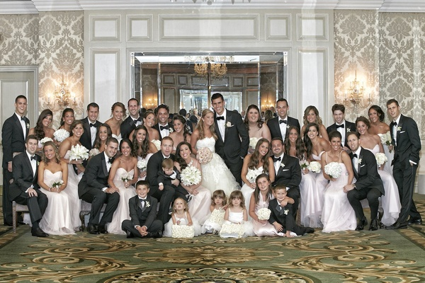 Couple with bridesmaids, groomsmen, and children