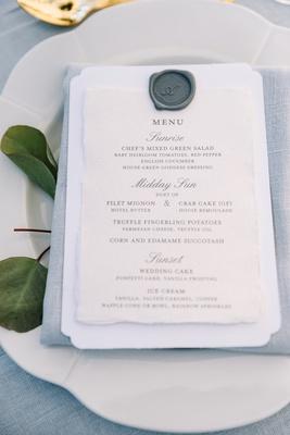 blue-grey napkin and linens, grey wax seal on menu
