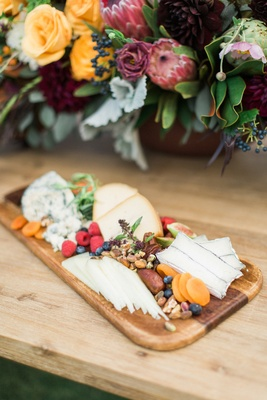wooden board fruits nuts cheeses california winter wedding styled shoot rustic boho ranch outdoors