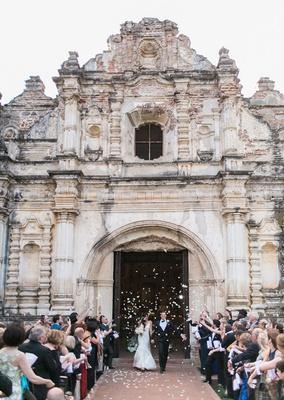 bride and groom leaving church doors guatemala destination wedding flower petal toss