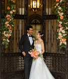 wedding inspiration styled shoot, bride in mira zwillinger, groom in tuxedo, gate with peachy floral