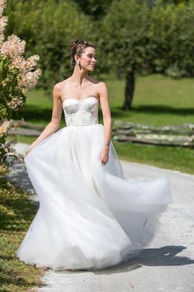 bride in strapless carolina herrera wedding dress pink green flower print design on bodice tulle