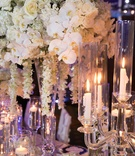 Wedding reception centerpiece white orchid white rose white cascading flowers candlelight floating