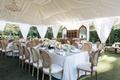 White tent with chandelier and rustic elegant wedding decorations