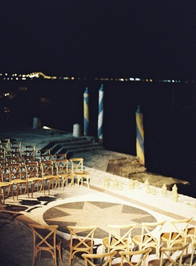 Wedding ceremony on tiled flooring at villa venue in Miami overlooking water Venice inspired