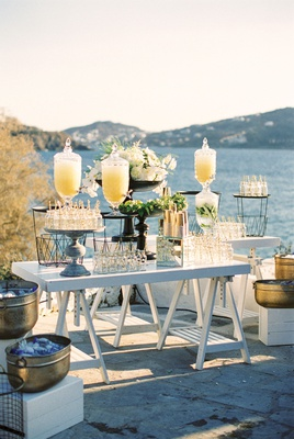 outdoor wedding ceremony refreshment station lemonade and water gold ice bucket mason jars straws