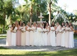 Bride in Vera Wang wedding dress with bridesmaids in Amsale and Monique Lhuillier