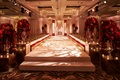 elevated white aisle indoor jewish wedding ceremony, red roses