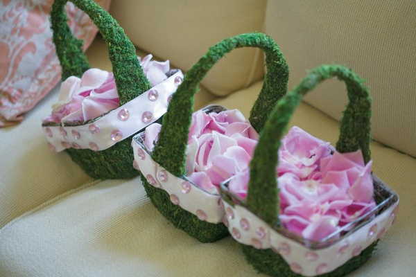 Moss-covered basket with pink petals