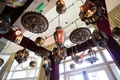 Moroccan-themed engagement party with Moroccan-style lanterns suspended overhead