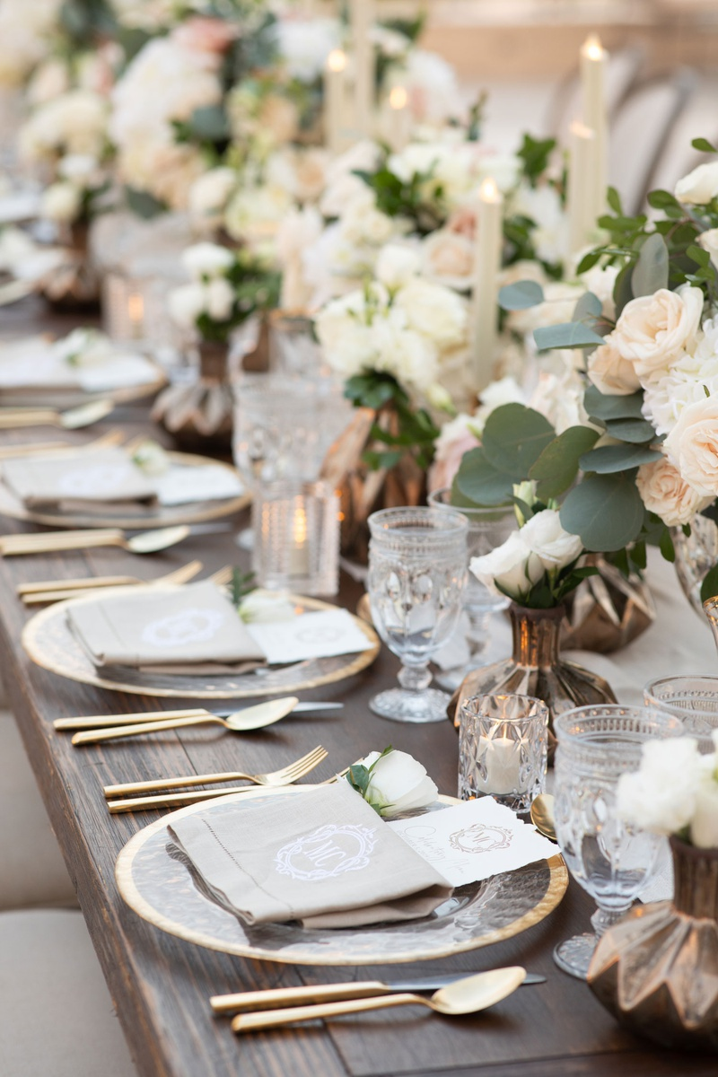 wedding tablescape decor gold flatware charger blush ivory flowers eucalpytus antique glassware