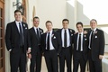 Groom and groomsman black suit attire