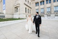 bride in v neck wedding dress tulle overskirt groom in tuxedo portraits at chicago field museum