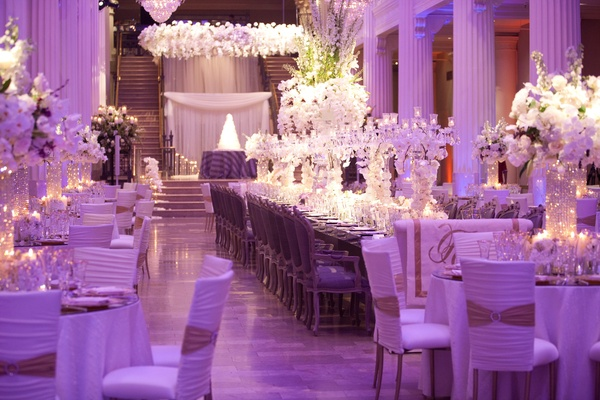 Purple wedding reception with head table and marble columns