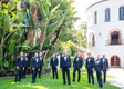 groom and groomsmen in navy blue suits with black bow ties yellow boutonniere flowers santa barbara