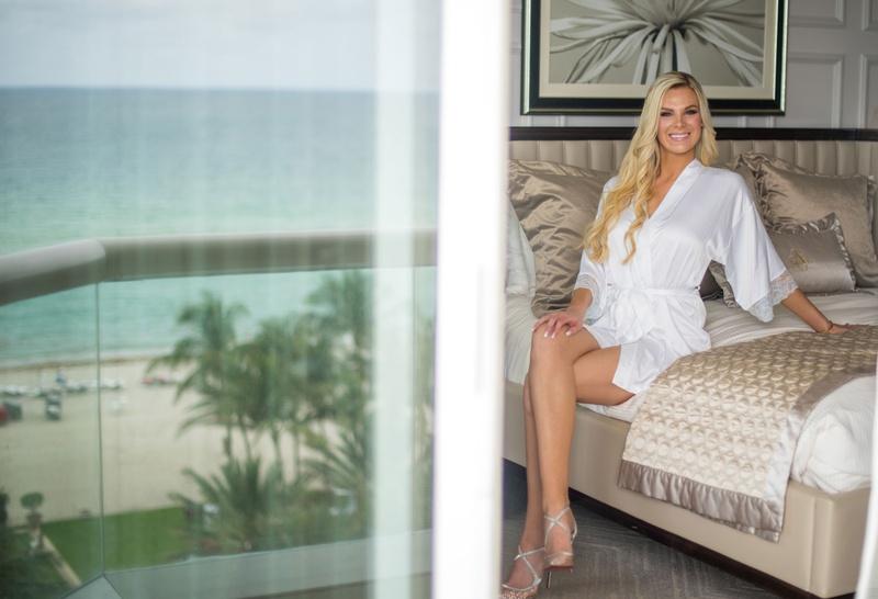 wedding photo of bride in white robe high heels long blonde hair acqualina resort and spa florida