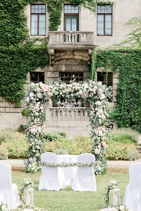 wedding ceremony in germany castle venue outdoor chandelier pink white flowers sage greenery white