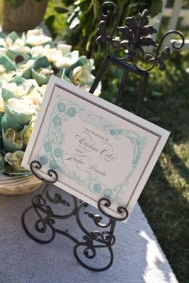 Aquamarine art design on wedding ceremony signage