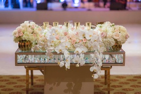 Sweetheart table with glass layers crystals in between orchid rose flower arrangement candles gold