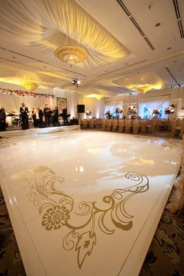 White dance floor with gold artistic design at corners