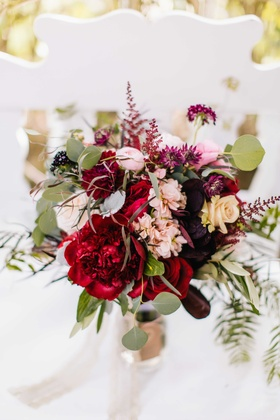 marsala wine colored bouquet with deep hues of red purple ivory and pink with greenery